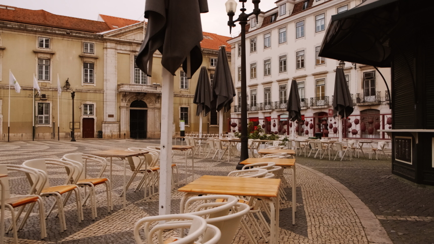 EUROPE IN LOCKDOWN - A popular outdoor cafe in the downtown of a Mediterranean capital lies deserted, following the number of cases of CORONAVIRUS / COVID-19, with a dramatic impact on social life | Shutterstock HD Video #1049117218