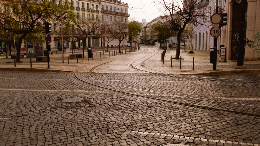 EUROPE IN LOCKDOWN - A large carriageway and tramway of an European capital lies deserted, following the rise in the number of cases of CORONAVIRUS / COVID-19, with a dramatic impact on social life | Shutterstock HD Video #1049117224
