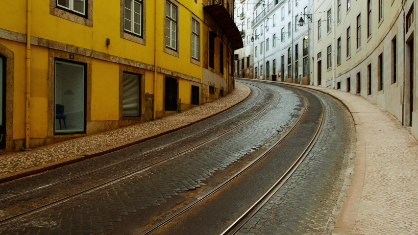 EUROPE IN LOCKDOWN - A quaint tramway of an European capital lies deserted, following the steep rise in the number of cases of CORONAVIRUS / COVID-19 infections, with a dramatic impact on social life | Shutterstock HD Video #1049117263