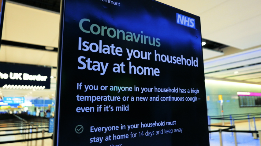 LONDON, circa 2020 - Close-up view of a CORONAVIRUS information panel in a popular UK airport, urging people to stay at home, following the number of cases of CORONAVIRUS / COVID-19 infections