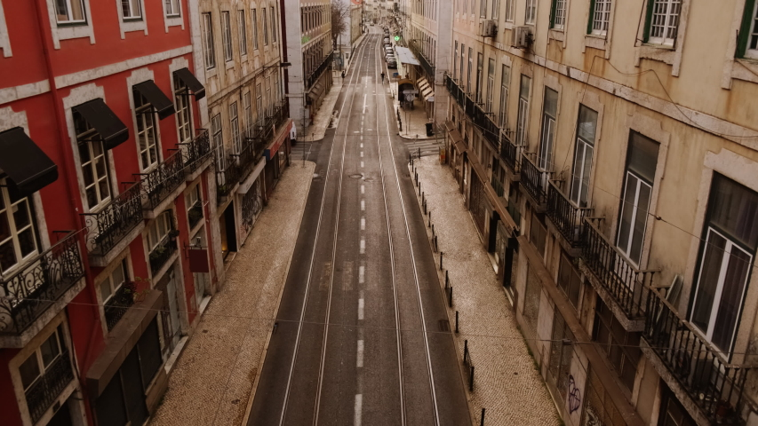 EUROPE IN LOCKDOWN - A busy carriageway of an European capital is deserted, following the steep rise in the number of cases of CORONAVIRUS / COVID-19 infections, with a dramatic impact on social life | Shutterstock HD Video #1049117314