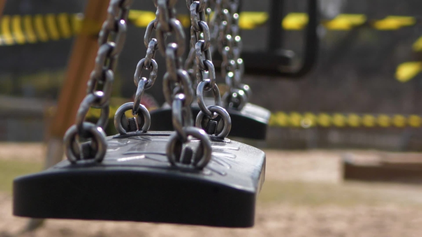 The playground is closed, close-up, swing moves Royalty-Free Stock Footage #1049120065