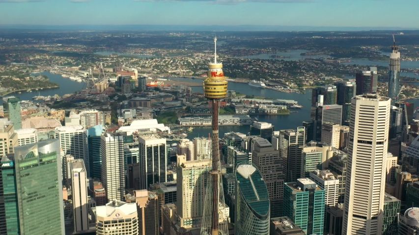 SYDNEY, AUSTRALIA – MARCH 20, 2020: Panoramic aerial view of Sydney city and Sydney Harbour on a sunny morning in Sydney, Australia