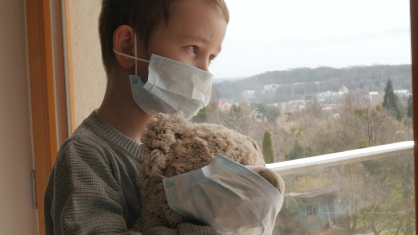 young boy, kid, child with protective mask with teddy bead, home quarantine Royalty-Free Stock Footage #1049154694
