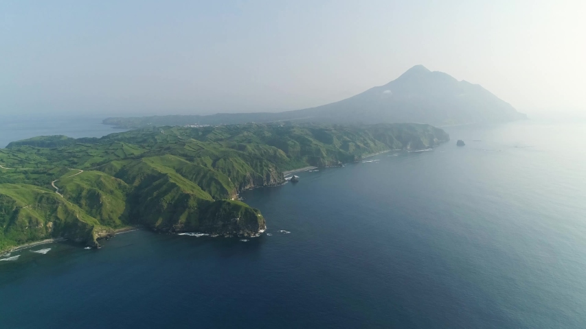 Drone shot with fishman on a boat in Batan in Philippine ocean | Shutterstock HD Video #1049157187