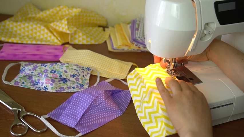 Eco-friendly Upcycled mask, Cotton Face Mask. A Woman volunteer Sew at Home a Fabric Face Mask Washable and Reusable | Shutterstock HD Video #1049172028