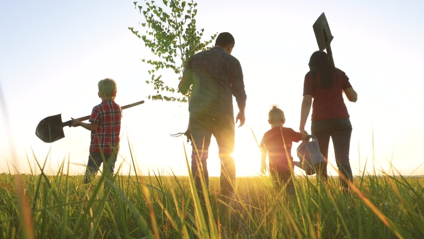 Agriculture red neck farming happy family walking agriculture of farmers a silhouette concept slow motion video. mom dad son and daughter walk go children happy family plant lifestyle and water the