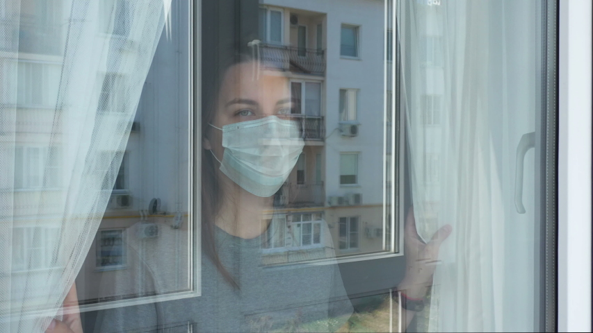 Woman in Quarantine Looking out the Window. Staying Home in Self-Quarantine Royalty-Free Stock Footage #1049189032