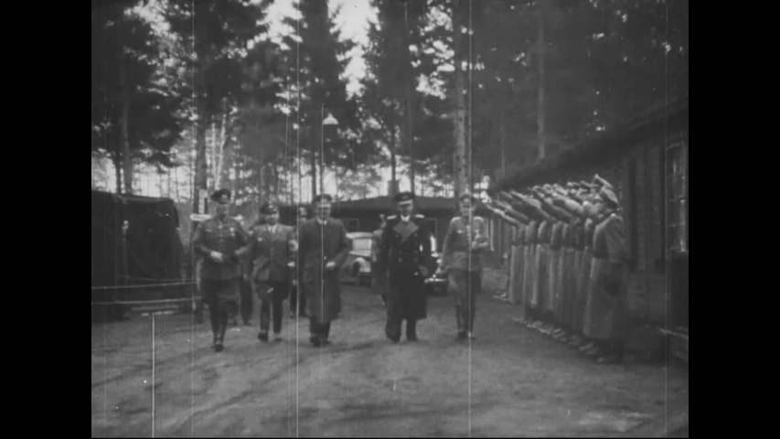 CIRCA 1940s - Adolf Hitler walks with officers and Nazi troops walk with a tank and a funeral is shown in Germany in World War 2.