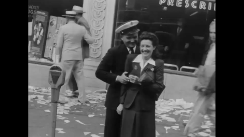 CIRCA 1945 - Men and women of the US Navy celebrate the end of World War two V-J Day with civilians in Seattle Washington.