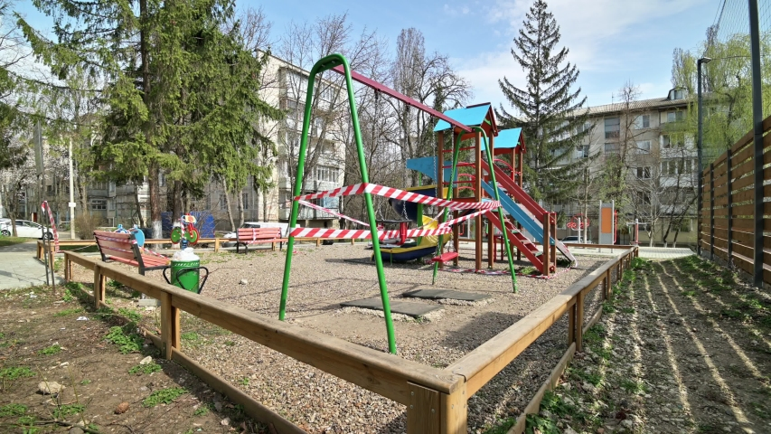 Chisinau, Moldova - March 27, 2020: Empty blaocked children playground in residential area during quarantine by reason of coronavirus AKA covid-19 virus threat. State of emergency declared in Moldova | Shutterstock HD Video #1049202898