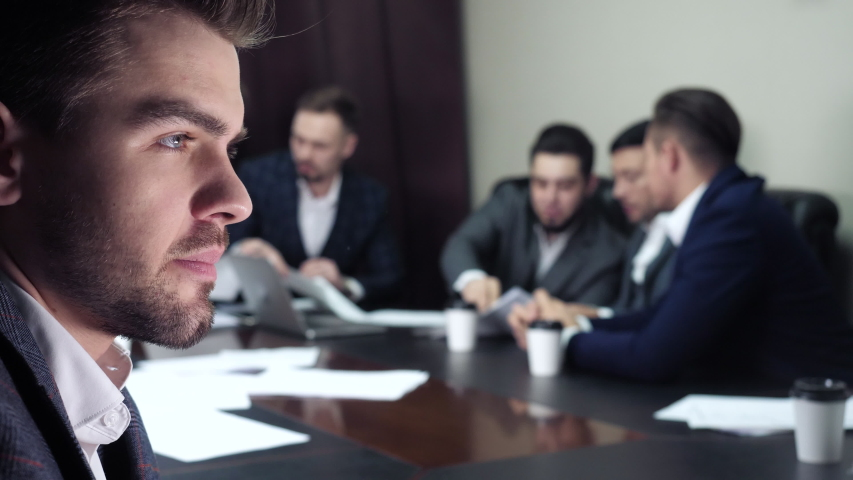 Thoughtful Indifferent Concentrated Ceo Boss Experiencing Anxiety, Feel Doubt During Discussion of Businesspeople Coworkers Indoor. Uncertain Concern Challenge, Strategy Dilemma of Worried Tense Chief Royalty-Free Stock Footage #1049221873