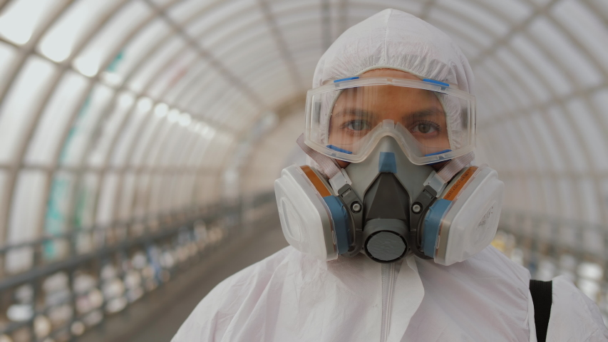 Portrait virologist medical worker in protective suit, goggles and respirator. Covid-19 coronavirus global epidemic spreading prevention, USA, Italy, Europe | Shutterstock HD Video #1049236513