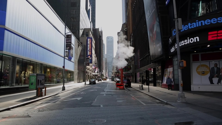 New York. March 27 2020. Virtually Empty Times Square and Midtown streets due to Coronavirus COVID-19 outbreak and Stay at Home regulation issued by Governor Cuomo