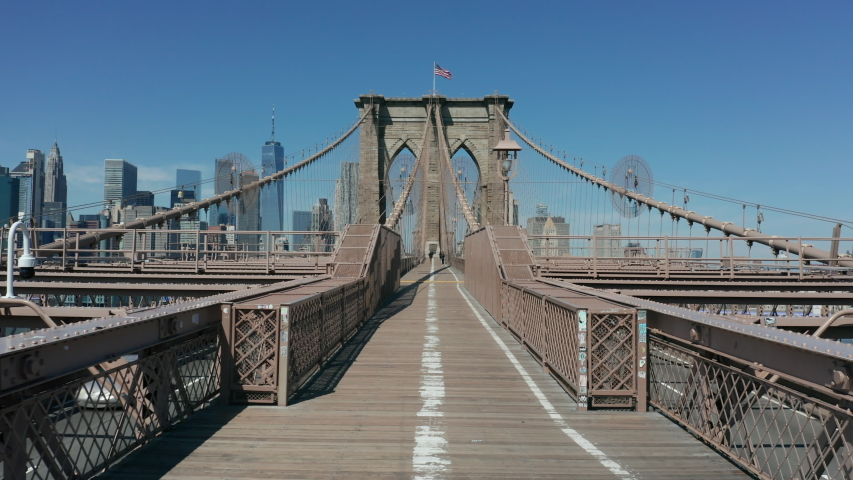 Moving forward along empty pedestrian path on Brooklyn Bridge corona quarantine