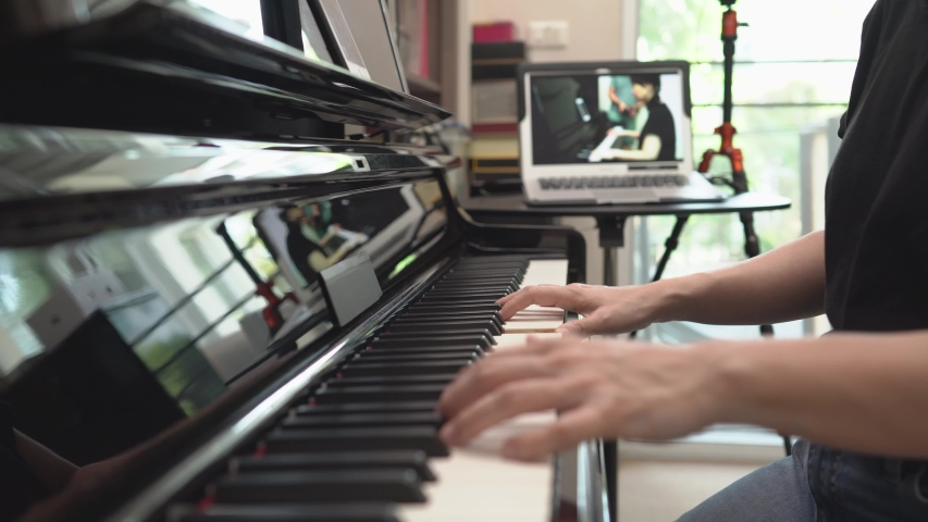 Online learning piano lessons, Online training or E-learning scene of instructor broadcasting class to network, vlog or teacher make online piano lesson to teach students pupils learn from home. Royalty-Free Stock Footage #1049254414