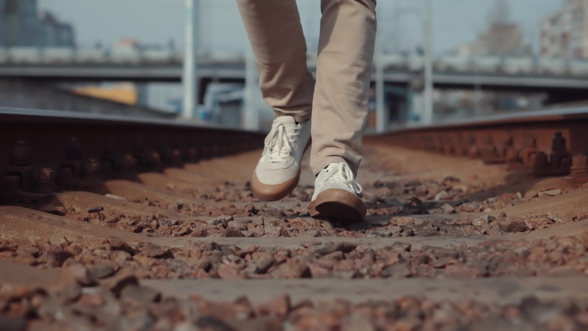 Man Walks To Home On Railroad Tracks After Canceled Public Transport .Tourist Legs Walking On Railway Middle Of Rail.Lonely Businessman Feet In Pants Walking On Rail Road When Train Or Tram Cancelled | Shutterstock HD Video #1049276662