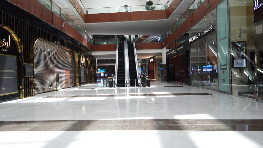 DUBAI, UAE - MARCH, 2020: Empty and abandoned shops inside the largest shopping mall in the world because of coronavirus, The Dubai Mall.