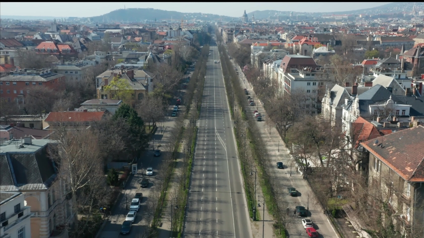 Empty tourist destination in Budapest, Hungary. People stay at home in self quarantine curfew, during the COVID-19 coronavirus.  Pest, Andrassy Avenue in abandoned view. Royalty-Free Stock Footage #1049306821