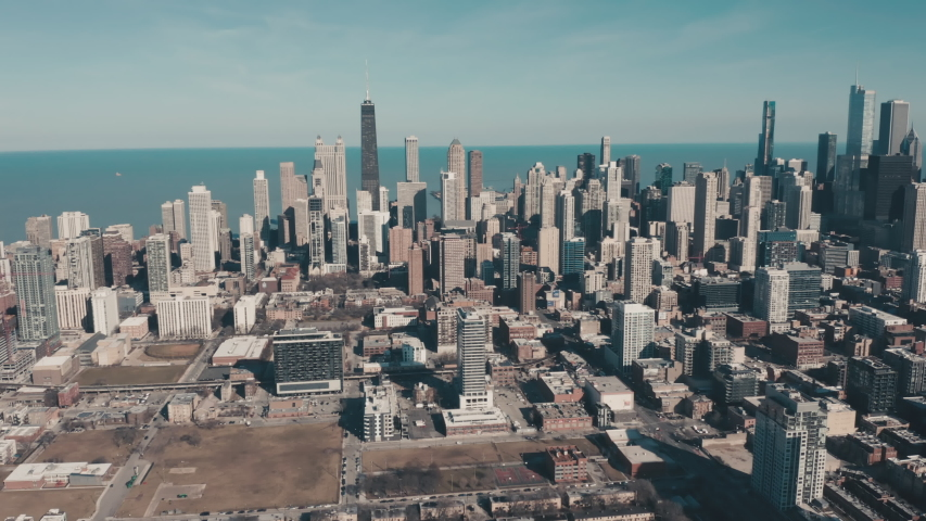 Aerial view of Chicago Downtown skyscrapers and Lake Michigan, United States. Vintage colors | Shutterstock HD Video #1049309599