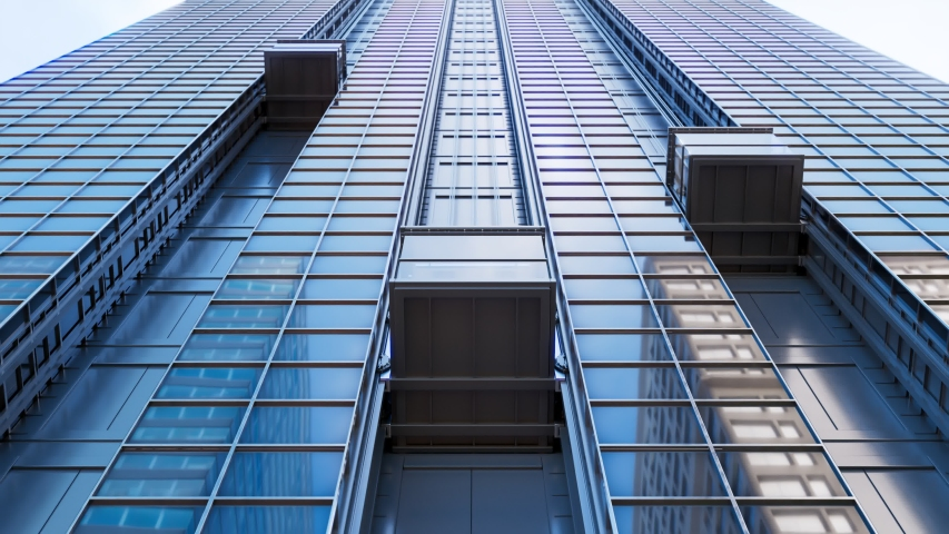 Three exterior elevator cabins travelling upwards on a skyscraper glass facade. Other downtown buildings reflected in shiny windows surfaces. Endless, seamless, looping animation.  Royalty-Free Stock Footage #1049319928