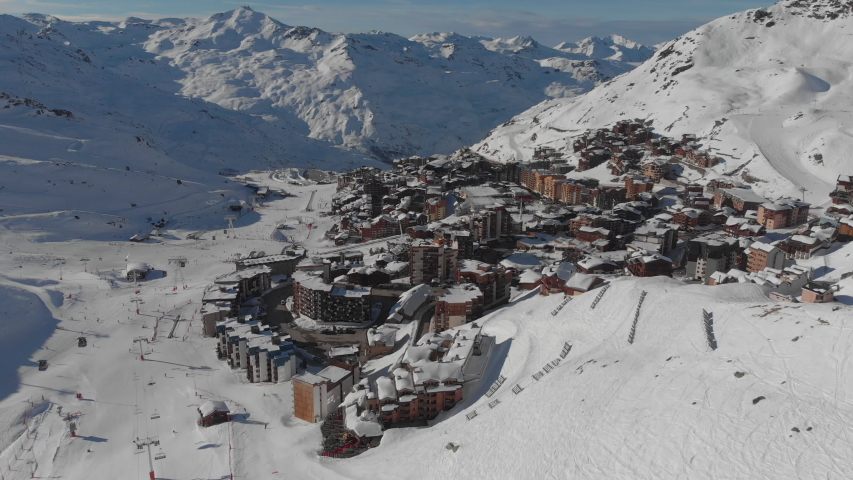 Aerial shot of people skiing in a french ski resort in the Alps VAL THORENS, FRANCE