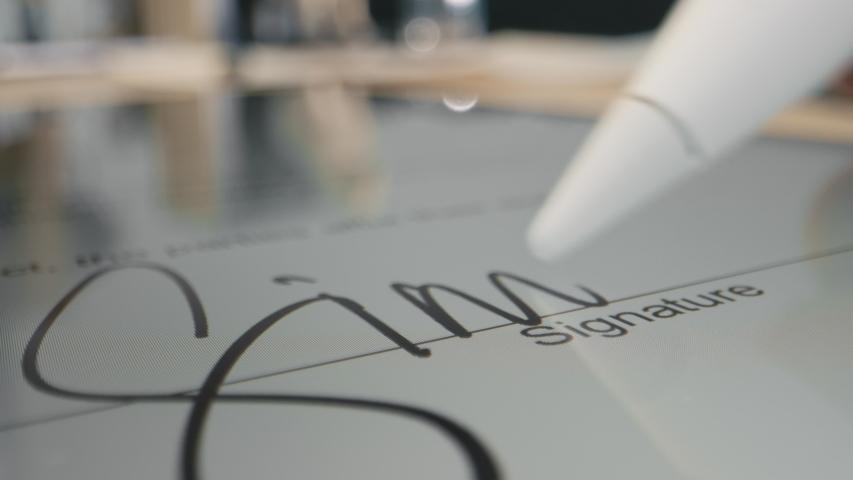 Electronic Signature on Tablet Computer by Pen in Male Hand. Sign Document of Deal on PC at Work in Office Indoors. Write Business Agreement for Partner. Executive Contract with Initials of Customer