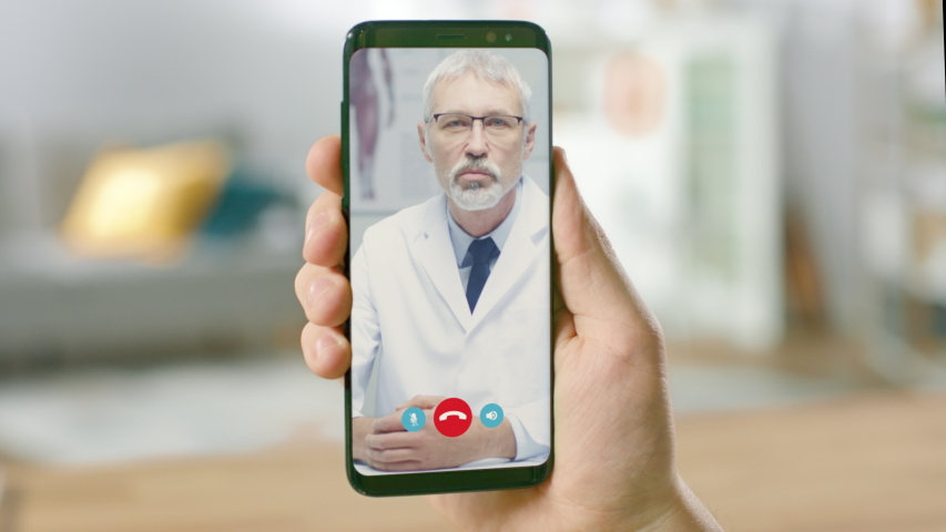 Point of View: Man Using Smartphone to Talk to His Doctor via Video Conference Medical App. Person Checks Symptoms, Talks with Physician, Using Online Video Chat Application. Close-up POV Camera