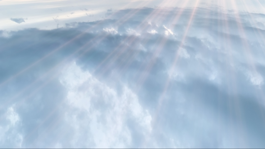 Beautiful view above the clouds. Flying over the morning timelapse clouds with the early sun. Flight moving cloudscape with beautiful sun rays. Clouds 4k stock footages.