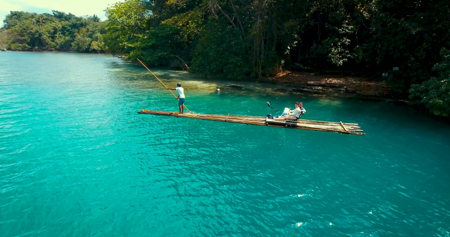 Jamaican Bamboo Rafting , blue water, beach    Shutterstock HD Video #1049405434