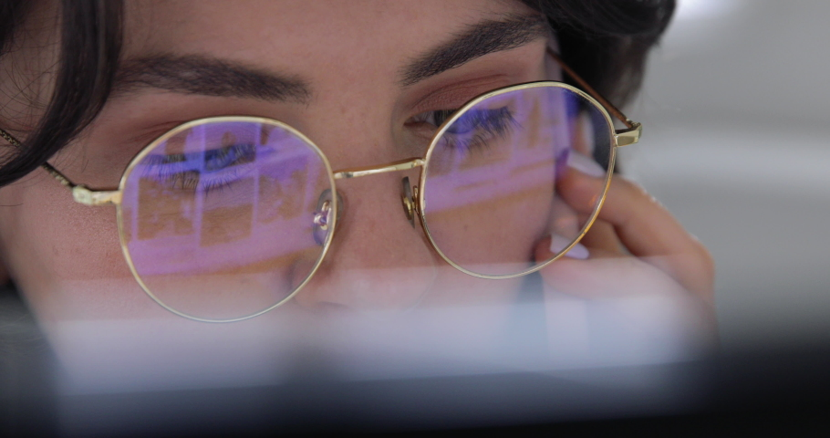 Closeup macro eyes of Smiling professional woman making a serious phone call, could be talking to a business contact or a friend. Home office desk, happy female customer make mobile call  | Shutterstock HD Video #1049405827