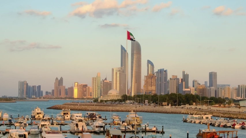Abu Dhabi cityscape at sunset, United Arab Emirates. Camera zooming in | Shutterstock HD Video #1049462494