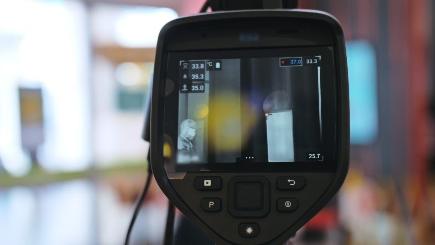 Temperature check at a supermarket, grocery store with thermal imaging camera installed. Image monitoring scanner to monitor the body temp of visitor customer. Coronavirus pandemic outbreak. Covid-19. | Shutterstock HD Video #1049486824
