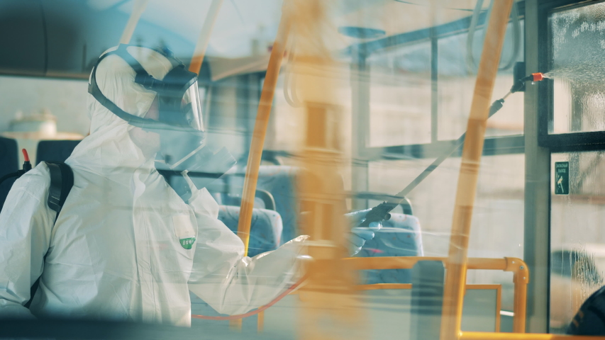 Coronavirus pandemic concept, disinfection process. Bus disinfection is being done by a sanitation worker Royalty-Free Stock Footage #1049509147