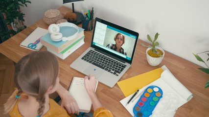 Online Lesson at Home. Teenager Girl Student Study with Teacher on Video Chat using Laptop. E-learning Classe, Distance course and Self-isolation concept at COVID-19 Pandemic. 4K Top View Orbit Shot