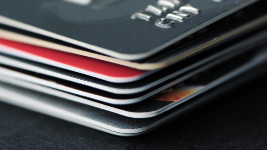 Time lapse of stack of credit cards close up.