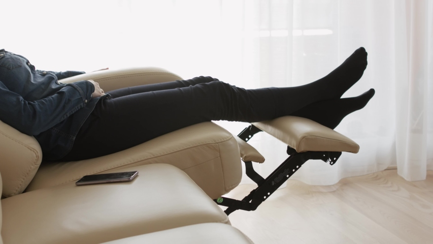 Woman resting in the reclining sofa. Quarantine and self isolation concept | Shutterstock HD Video #1049581141