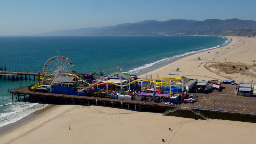 SANTA MONICA, CA - MARCH 30, 2020: Aerial view of a desolated Santa Monica beach and pier in Los Angeles, California as a result of Corona virus Covid-19 pandemic and stay-at-home quarantine.