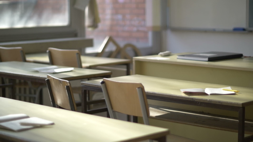 Empty high school classroom, no people