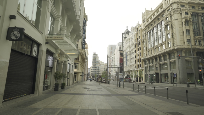 MADRID, SPAIN - MARCH 15 2020. Gimbal shot of eerily empty Gran Via, one of the usually crowdest avenues in downtown Madrid, during the first day of coronavirus lockdown.