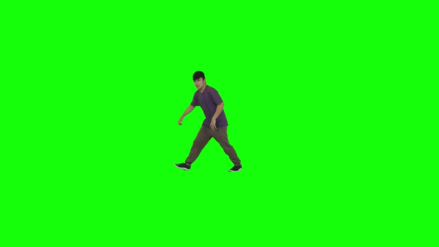 Handsome boy performing break dance in the studio. Shot in 4k resolution with green screen background
