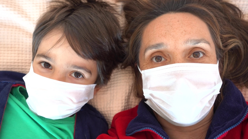 4K Selfie - Cheerful mother and child in masks look at each other