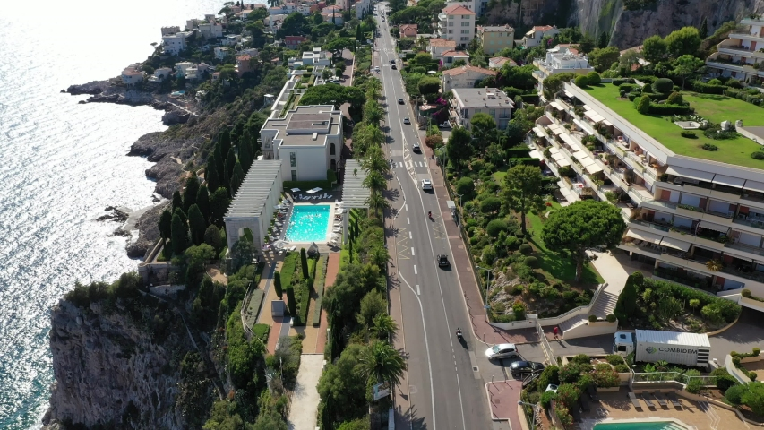 Beautiful flight over the Sunny coast of southern France. Cars drive along the road to nice along the sea. Cote d'azur, Nice. Aerial photography.