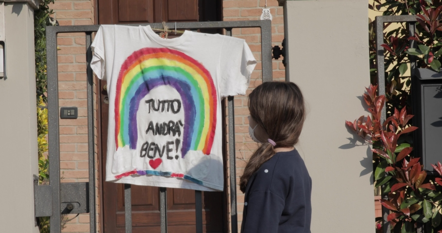 masked girl optimistic with rainbow in background translation: everything will be fine against  covid coronavirus | Shutterstock HD Video #1049689549