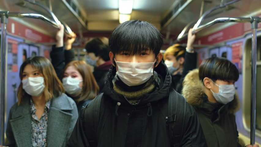 Asia Infect Corona Virus. Face Mask Covid-19 Subway Tube. Chinese Passenger. Epidemic Coronavirus Asian Man. Pandemic Flu Corona Virus. Crowd Masked 2019-ncov. Train Metro China. People Sick Covid 19. Royalty-Free Stock Footage #1049692216