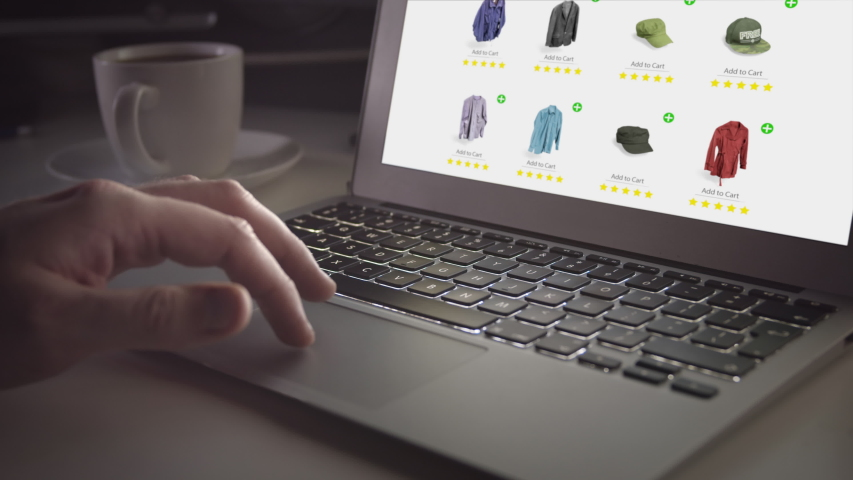 Close-up of Man's Hand Shopping for Clothes Online, Browsing Shop and Buying using Laptop at Night. Scrolls Catalog and Drinks Coffe Moving Fingers Over Touchpad. Searching for Products on Online. Royalty-Free Stock Footage #1049692750