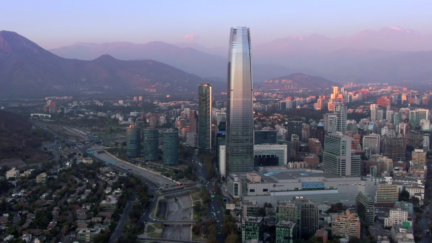 Aerial view of Santiago, the capital and largest city in Chile, showing landmark buildings in the financial district at sunset. | Shutterstock HD Video #1049695912