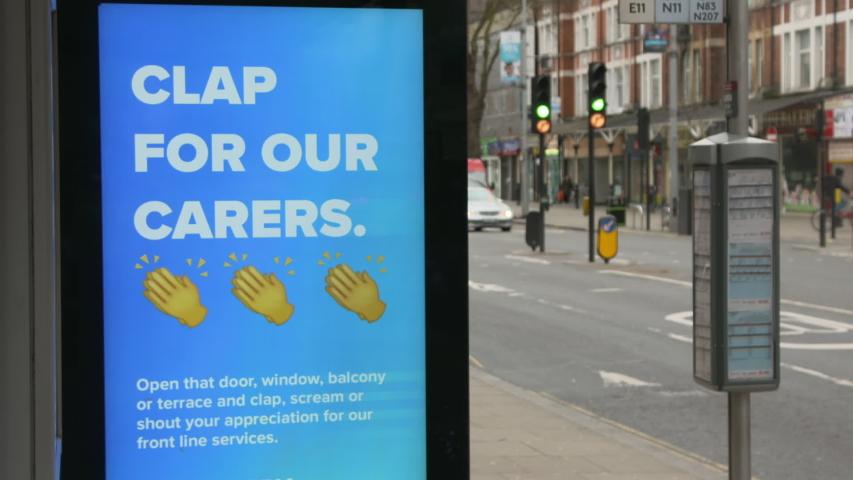 London, UK - April 02 2020: London Coronavirus Outbreak - TfL bus shelter advert supporting NHS during coronavirus pandemic