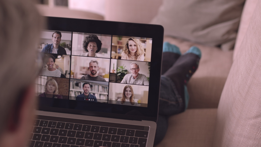 Person Using Video Conferencing technology from sofa for video call with colleagues at home and in offices | Shutterstock HD Video #1049745880