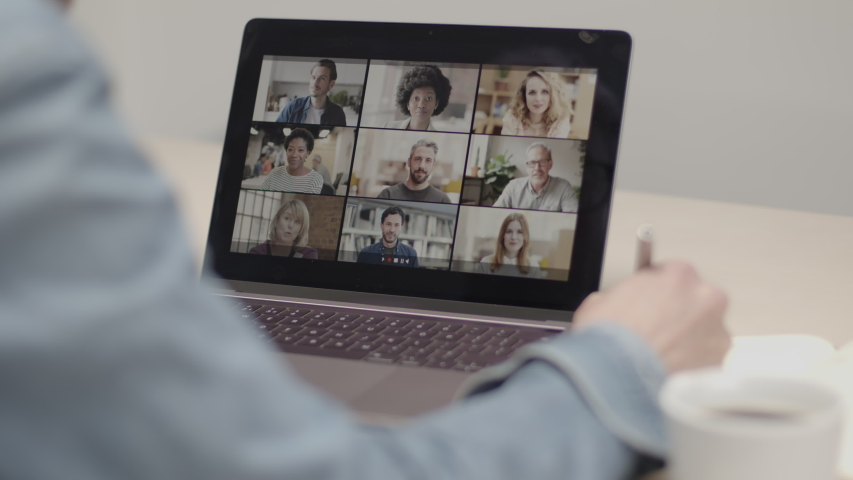 Person Using Video Conferencing technology in kitchen for video call with colleagues at home and in offices Royalty-Free Stock Footage #1049745883